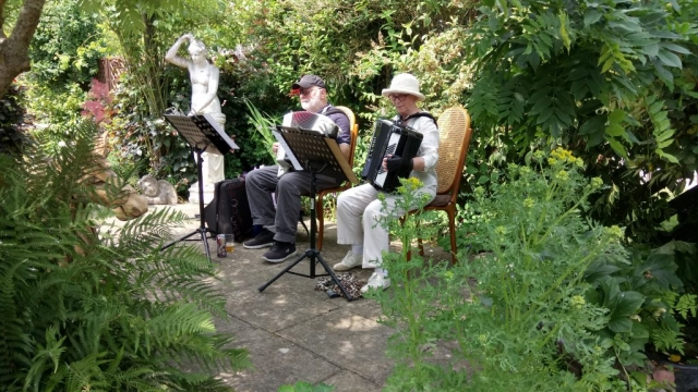 Freda and Ivan on accordion performing at Music In The Garden